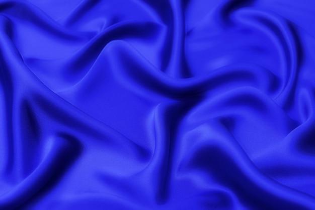 Fundo de textura de tecido azul, cor azul suave de tecido ondulado, cetim luxuoso ou textura de pano de seda.