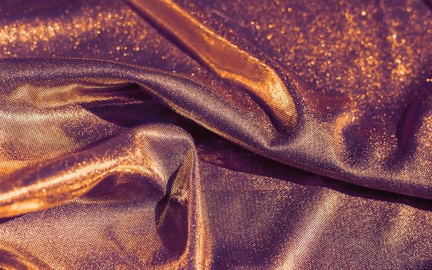 Fundo de textura de tecido brilhante dourado brilhante