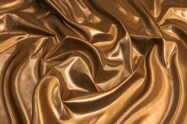 Fundo de textura de tecido de chiffon de seda de cor marrom abstrata.