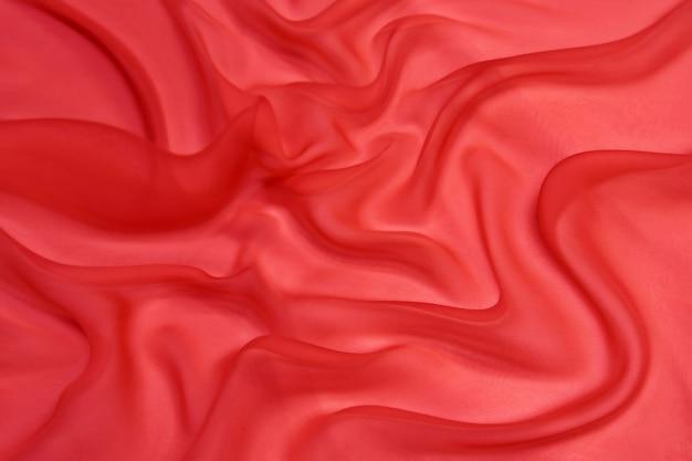 Fundo de textura de tecido de chiffon de seda de cor rosa abstrata.