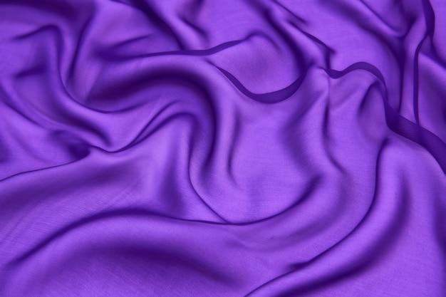 Fundo de textura de tecido de chiffon de seda de cor roxa abstrata.