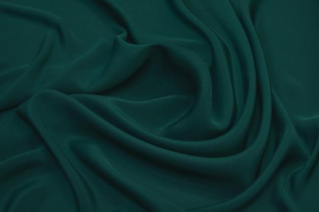 Fundo de textura de tecido de chiffon de seda de cor verde abstrato.