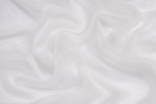 Fundo de textura de tecido de chiffon macio abstrato. chiffon branco macio com curva e padrão de ondas.