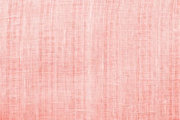 Fundo de textura de tecido de linho. conceito zero de resíduos. imagem em tons de coral viva.