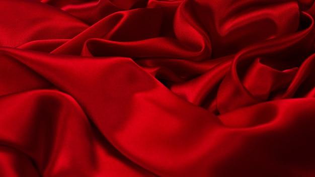 Fundo de textura de tecido de seda vermelho rico e luxuoso. vista do topo.