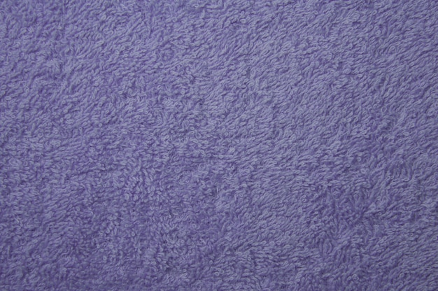 Fundo de textura de tecido de toalha violeta para uma superfície