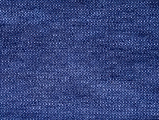 Fundo de textura de tecido não tecido ou spunbond azul marinho