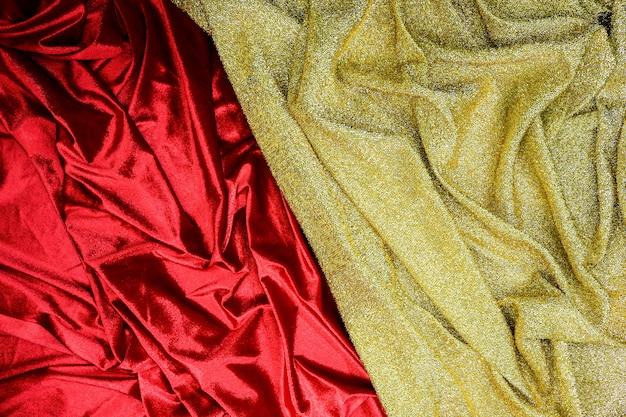 Fundo de textura de tecido vermelho e dourado