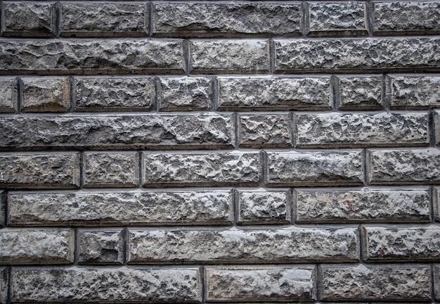 Fundo de textura de uma velha parede de pedra feita de calcário
