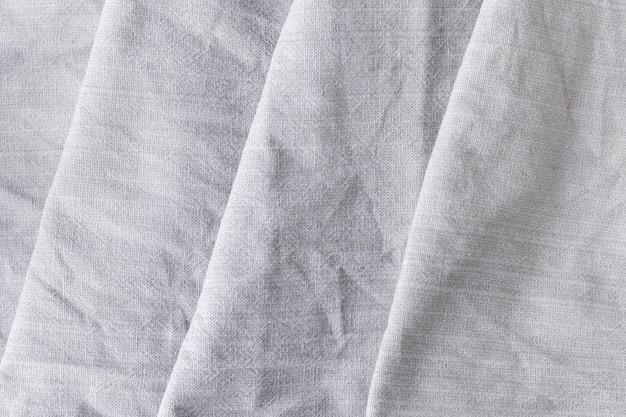 Fundo de textura diagonal de tecido de linho natural. textura áspera de serapilheira amassada. foco seletivo. vista de perto