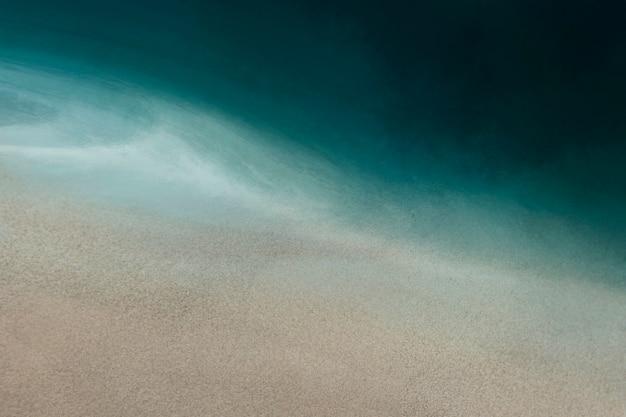 Fundo de textura em aquarela de areia e mar