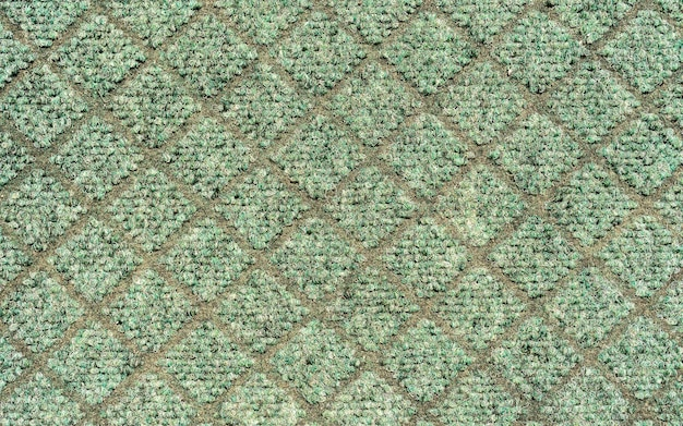 Fundo de textura em branco genérico sem costura tapete verde, padrão ao ar livre, close-up de textura de tecido plástico. padrão de diamante de contraste cinza