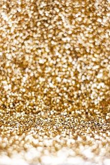 Fundo de textura glitter dourados em vista em perspectiva, uso para exibição de produto