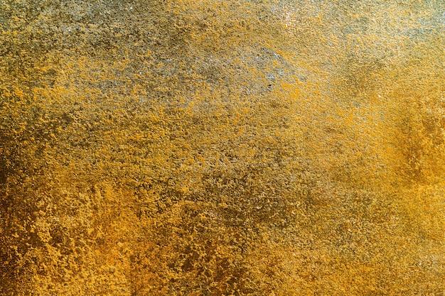 Fundo de textura grunge dourado bagunçado.