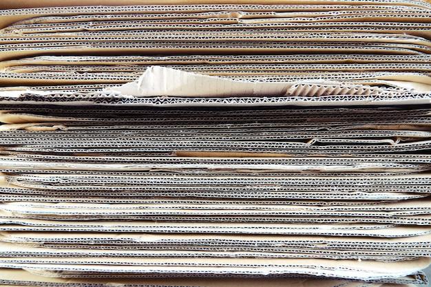 Fundo de textura material de papelão empilhados