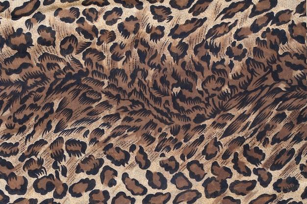 Fundo de textura padrão local leopardo. fundo ou textura de animal selvagem
