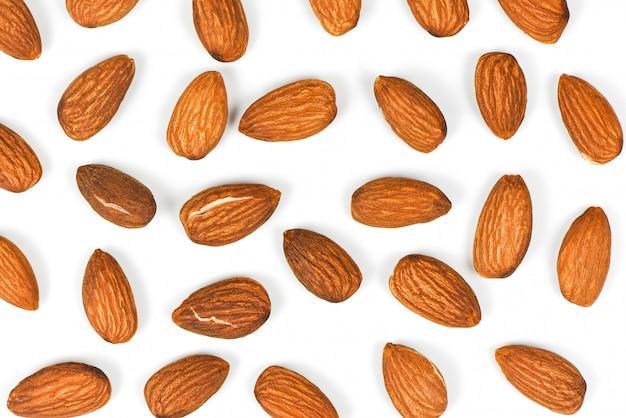 Fundo de textura sem emenda de amêndoas / close-up alimentos de proteínas naturais de amêndoas e lanche
