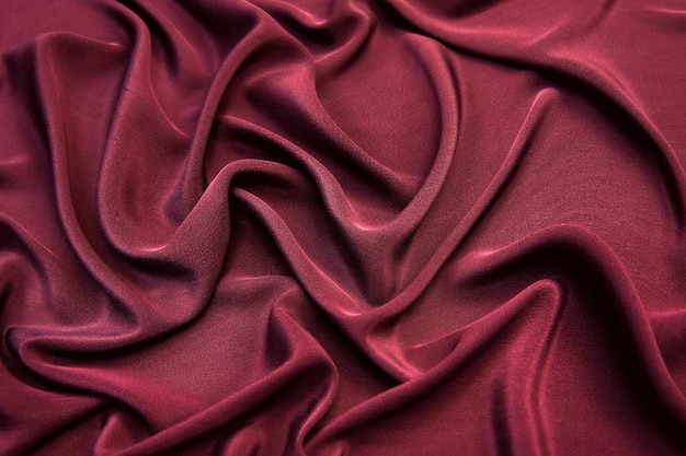 Fundo de textura suave e elegante de seda rosa vinho ou cetim para design