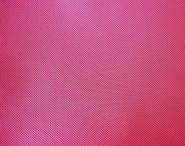 Fundo de textura têxtil de plástico rosa