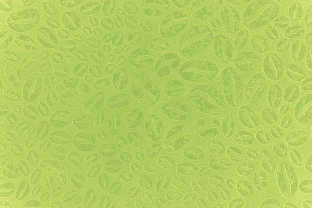 Fundo de textura verde claro e gasto com padrão de grãos de café