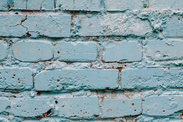 Fundo de tinta para parede de tijolo na cor azul brilhante.