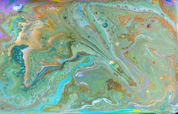 Fundo de tintas coloridas misturadas. teste padrão multicolor com glitter dourado.