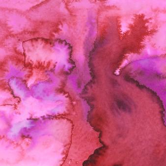 Fundo de traços de pincel de tinta aquarela vermelho e rosa