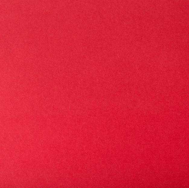 Fundo de um cartão de cores vermelhas