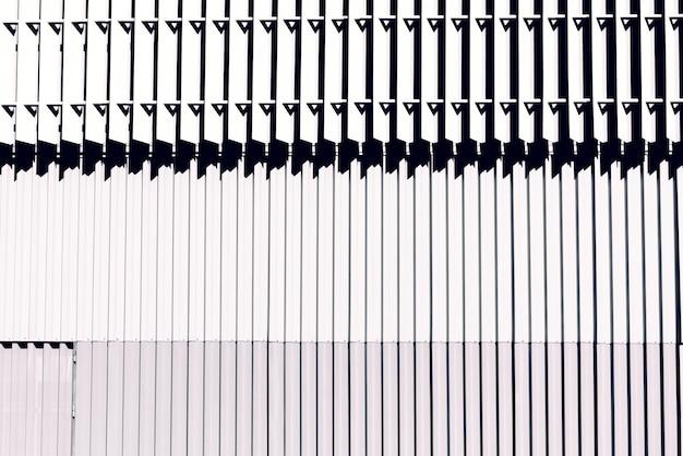 Fundo de uma parede do metal com linhas brancas.
