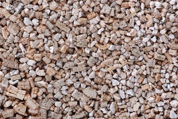 Fundo de vermiculita. fundo de textura esfoliada perlita e vermiculita. mineral usado na jardinagem.