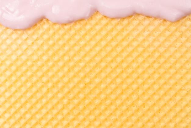 Fundo de waffle doce com creme. espaço para texto ou desenho.