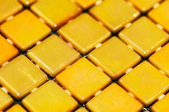 Fundo decorativo mosaico amarelo texturizado