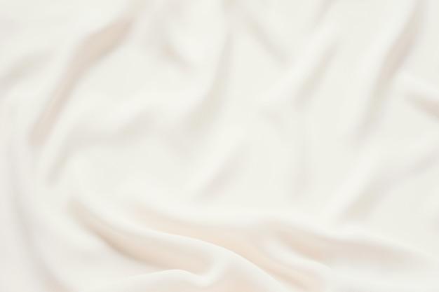 Fundo delicado macio delicado de creme matte da tela. textura de pano de luxo elegante suave.