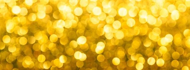 Fundo desfocado bokeh amarelo abstrato. belo fundo para o natal ou projeto romântico. formato largo do banner.