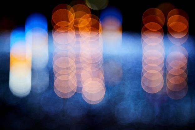 Fundo desfocado colorido de luz decorativa à noite