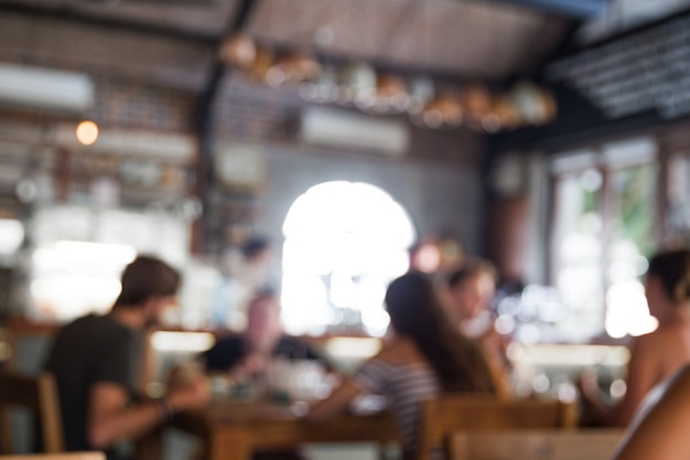 Fundo desfocado de pessoas no café. oportunidade social de comunicação.