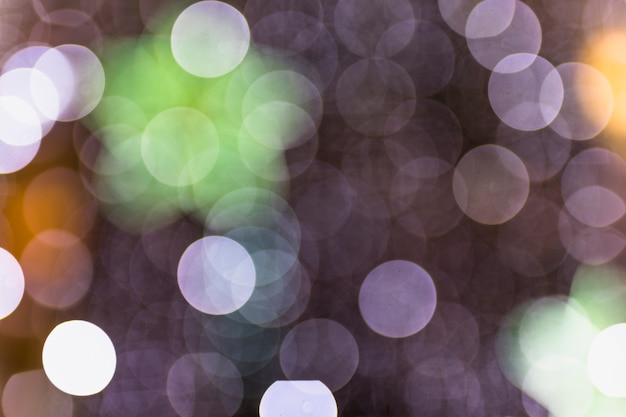 Fundo desfocado do ponto de luz colorido