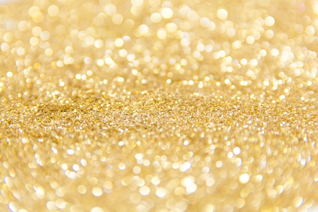 Fundo desfocado glitter dourados. fundo abstrato bokeh ouro. abstrato de natal