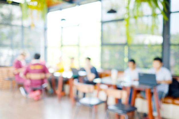 Fundo desfocado: grupo de pessoas borrão reunião de equipe no espaço de co-working