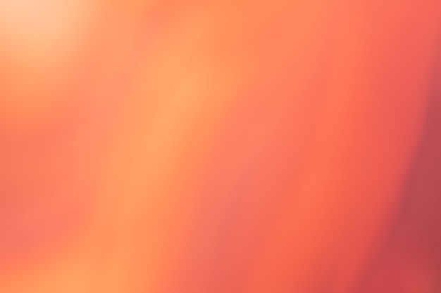 Fundo desfocado vermelho e laranja. cenário gradiente de gengibre abstrato arte desfocado com blur e bokeh.