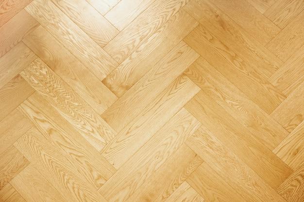 Fundo do assoalho interior do padrão clássico da textura de madeira marrom.
