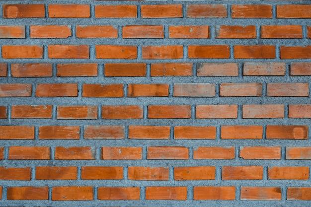Fundo do fragmento da parede de tijolo vermelho ou textura da construção da camada de tijolo.