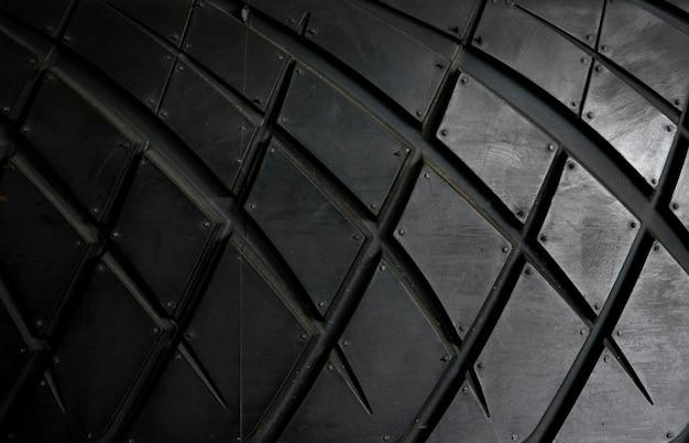 Fundo do pneu de carro, fundo do close up da textura do pneu.