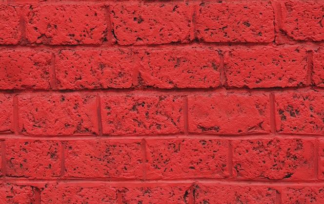 Fundo do sumário da cor vermelha de parede de tijolo.