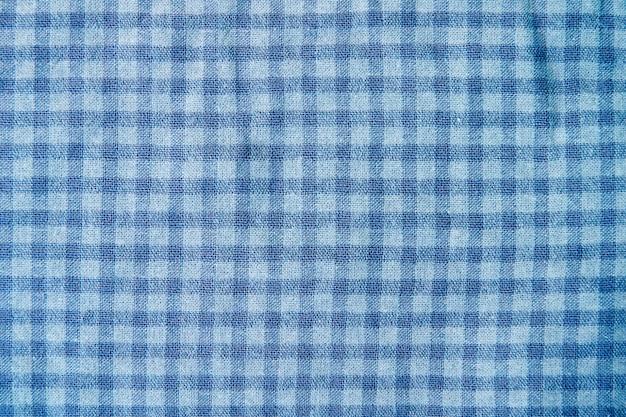 Fundo do teste padrão da toalha de mesa quadriculado com obscuridade - azul. fundo de textura de piquenique