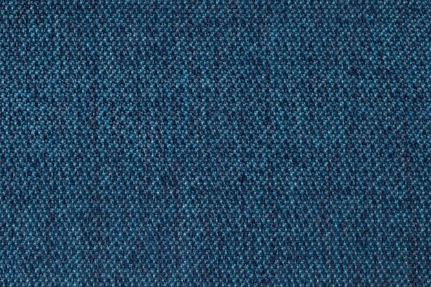 Fundo dos azuis marinhos da matéria têxtil de lã da textura, close up. estrutura da macro de tecido de vime.