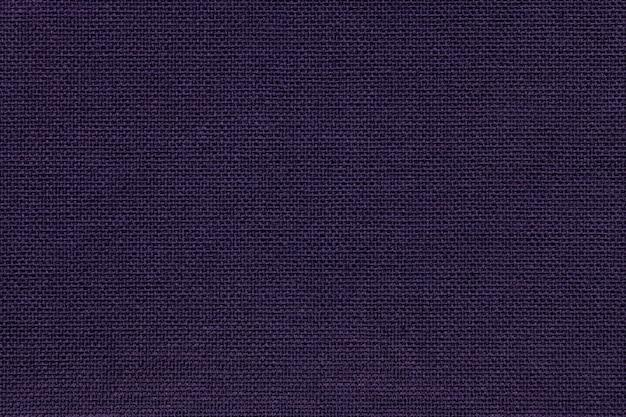 Fundo dos azuis marinhos de um material de matéria têxtil com teste padrão de vime, close up.