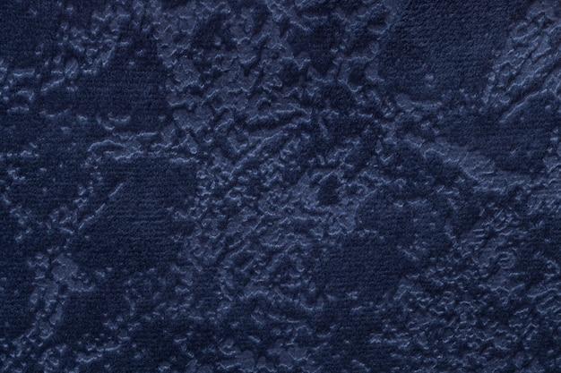 Fundo dos azuis marinhos de um material de matéria têxtil macio de estofamento, close up.