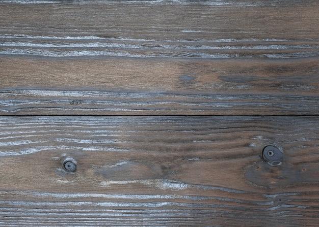 Fundo dos painéis de madeira matizados em um tom de chocolate. minimalismo.
