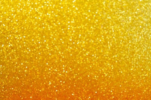 Fundo dourado abstrato. efeito bokeh bonito. fundo de círculos de luz.